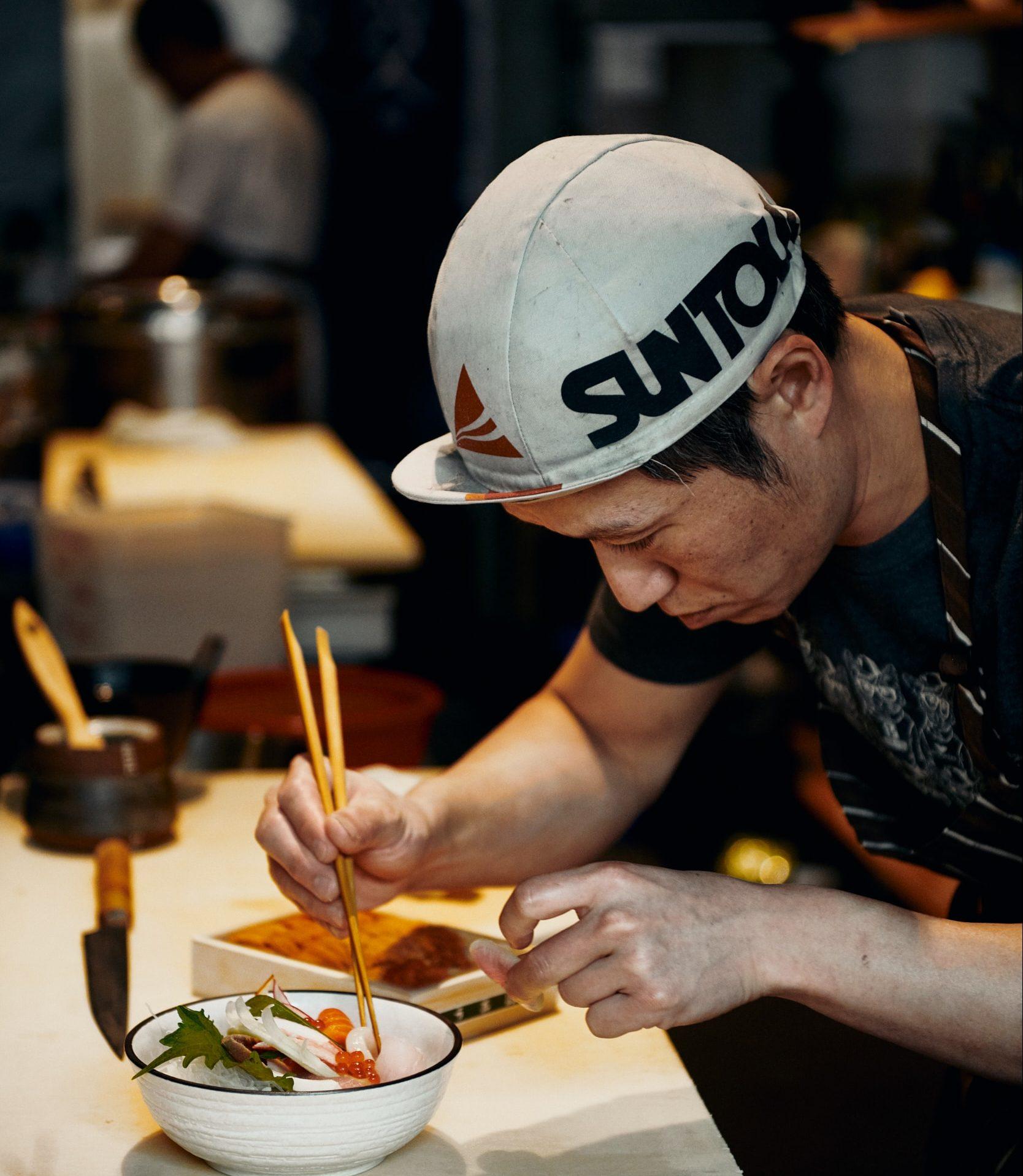 Man Eating at Kuma Sushi and Sake Near 1433 Bush